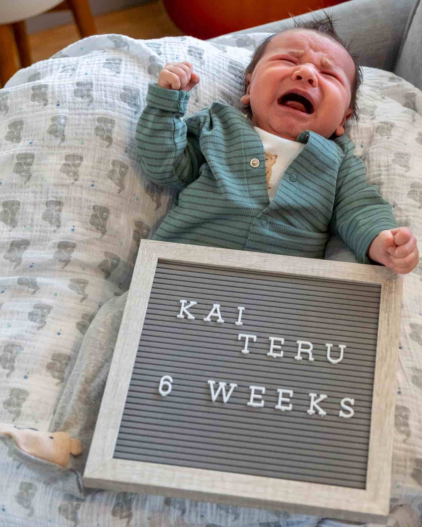 cute baby with framed felt letter board